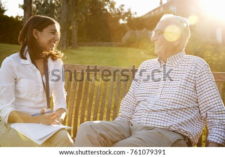 Woman Visiting Senior Male Relative In Assisted Living Facility
