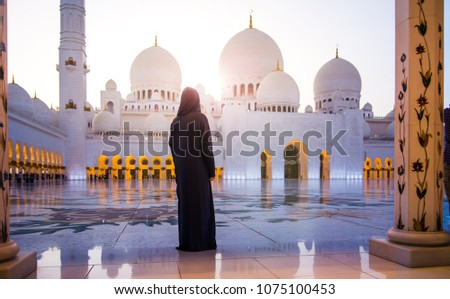 Woman visiting the Grand Mosque in Abu Dhabi #1075100453