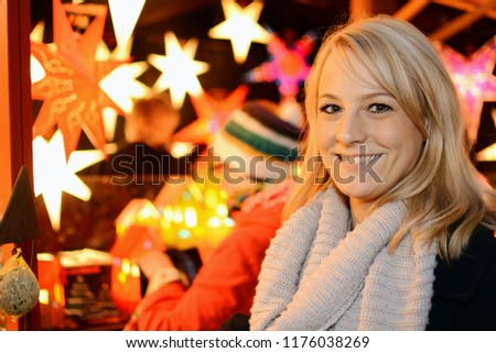 Woman visits Christmas market with many stalls and for Advent and winter #1176038269
