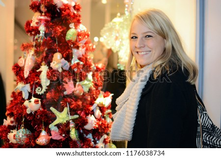 Woman visits Christmas market with many stalls and for Advent and winter #1176038734