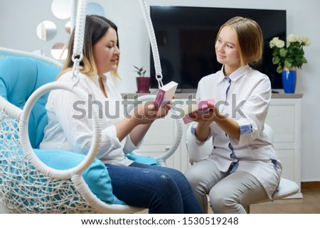 Woman visits young cosmetologist doctor. The doctor consults with the patient #1530519248