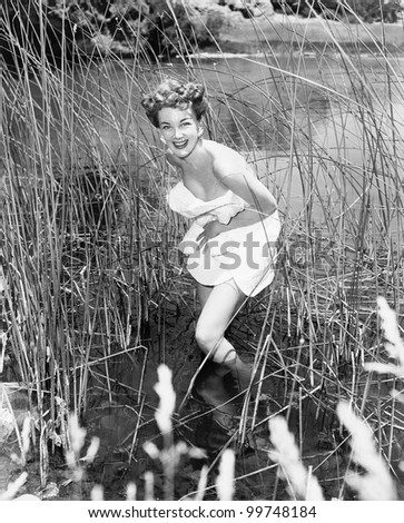 Woman wading in reeds