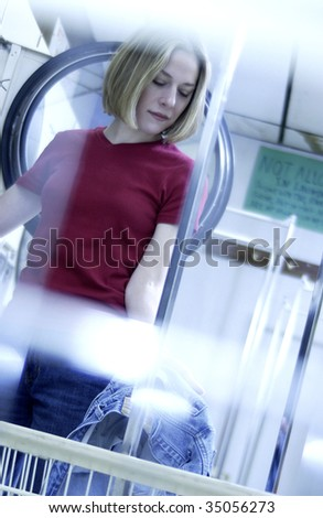 woman waiting at laundromat