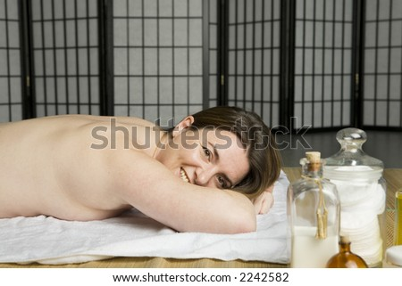 Woman waiting for a massage in a spa