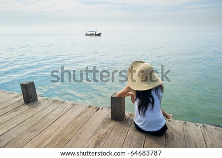 woman waiting for boat at the dock