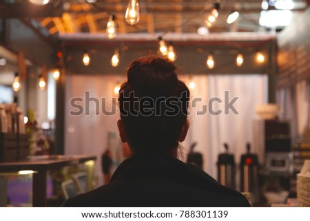 Woman waiting for her coffee at a cafe #788301139