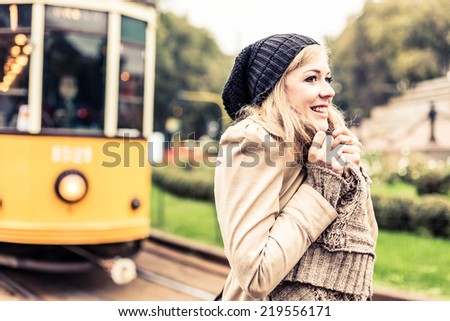 Woman waiting for the Tram