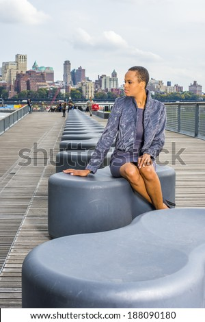stock-photo-woman-waiting-for-you-dressing-in-a-gray-patterned-faux-fur-jacket-a-woolen-fitted-dress-open-188090180.jpg