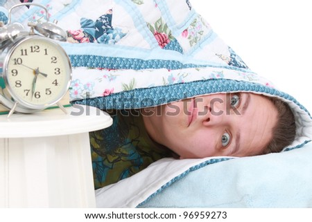 Woman waking up to alarm clock