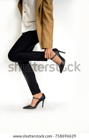Woman walk on the high heeled shoe,some problem, broken lift side high heeled shoe, her get in jured her foot. #758696629