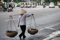 woman walk selling things in Hanoi,Vietnam