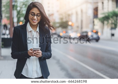 Woman walking and chatting with friends outdoor in city centre #666268198