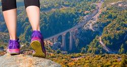 Woman walking (hiking) go up a mountain - Woman walking sport feet on trail healthy lifestyle fitness -  Aerial view of Varda railway bridge - Adana, Turkey