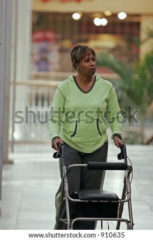 woman walking in mall using walker
