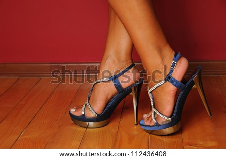 Woman walking on high heels.