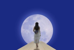 Woman walking to the moon.