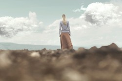 woman walking towards infinity in a magical and surreal place
