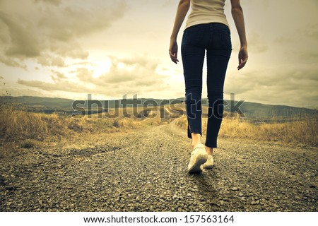 woman walking towards unknown places