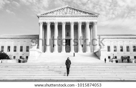 Woman Walking Up The Stairs Of Supreme Court of the USA ストックフォト ©