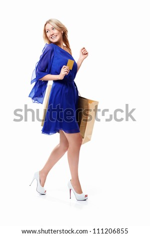 Woman walking with shopping bags and credit card