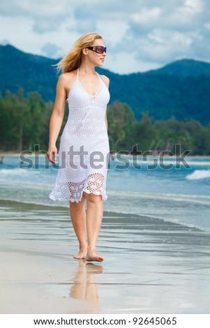 woman walks on a beach