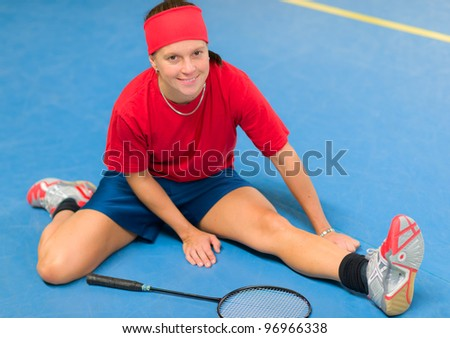 Woman warm-down before the badminton game.