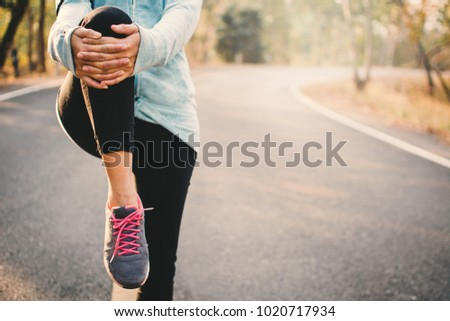 Woman warm up before running on the road for health, color of hipster tone selective and soft focus