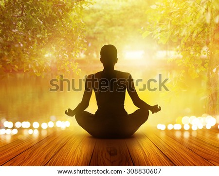 woman was meditating in sunrise and rays of light on park and nature, soft focus #308830607