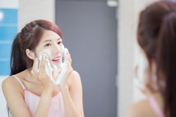 woman wash her face in the bathroom