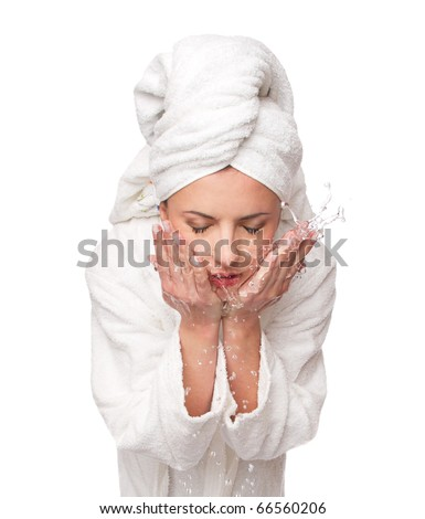 woman washes her face. studio, isolated at white background