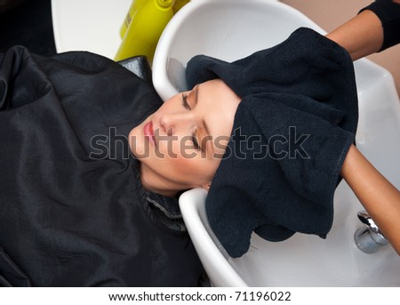 woman washing hair in salon