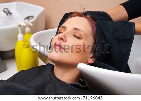 woman washing hair in salon