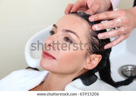 woman washing hair in salon pool