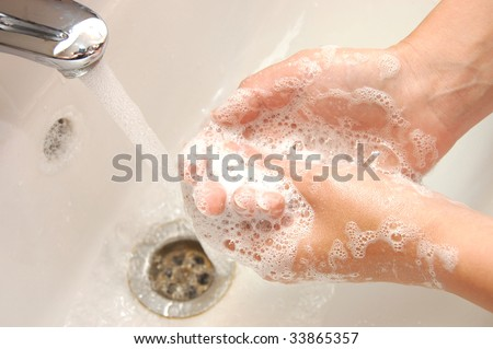 woman washing hand under running