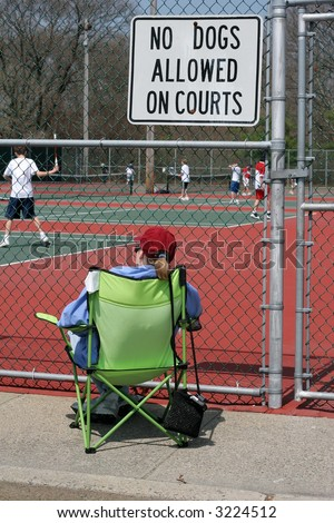 woman watching tennis match