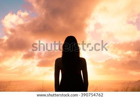 Woman watching the beautiful sunset.