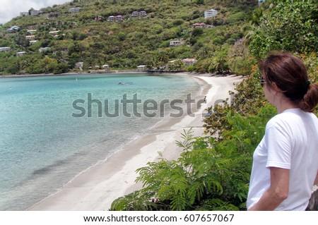 Woman watching tropical island of Cane Garden Bay in Tortola