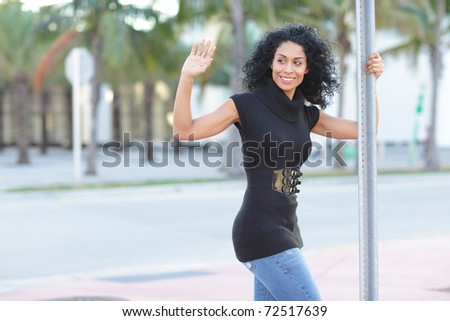 Woman waving and smiling