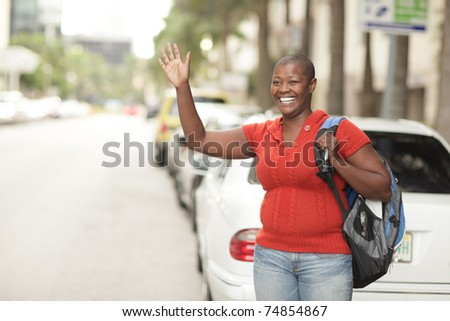 Woman waving on the street