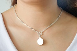 Woman wearing a mockup montage necklace with empty for add your advertising.