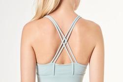 Woman wearing a sports bra mockup with criss cross strap