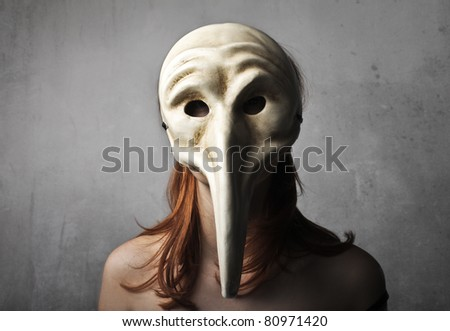 Woman wearing a vintage mask