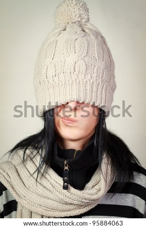 woman wearing a winter hat and scarf