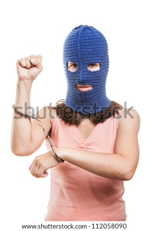 woman wearing balaclava or mask on head showing handcuffs on hands white isolated