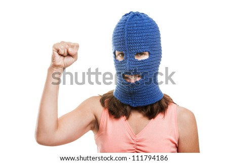 woman wearing balaclava or mask on head showing raised fist hand gesture white isolated
