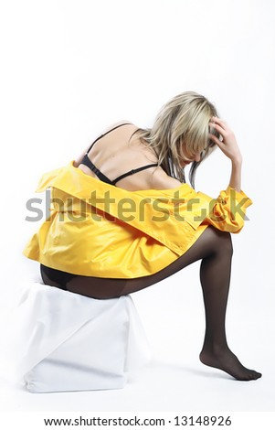 woman wearing black lingerie and yellow jacket on white background