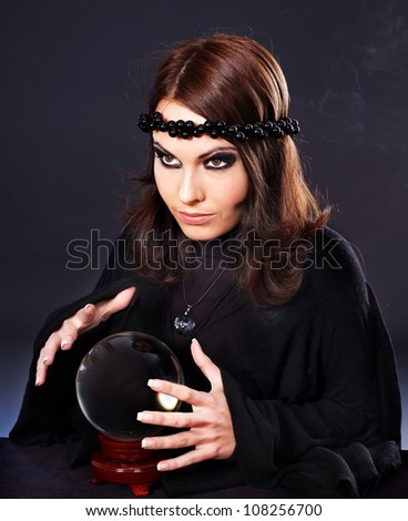 Woman wearing black with crystal ball. Fortune telling.