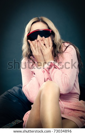 woman wearing 3d glasses at home