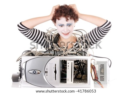 woman wearing face paint very upset with computer