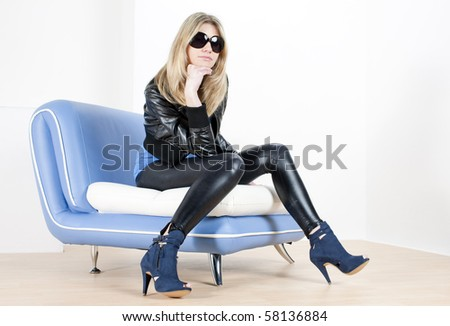 woman wearing fashionable shoes sitting on sofa